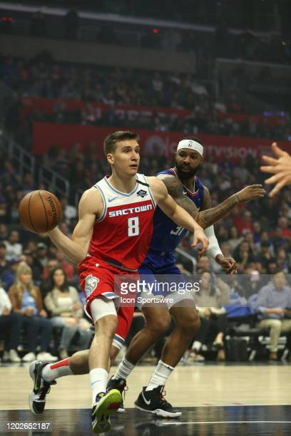 Sacramento Kings guard Bogdan Bogdanovic dribbles past Los Angeles Clippers forward Marcus Morris Sr during the game on February 22 at Staples Center...