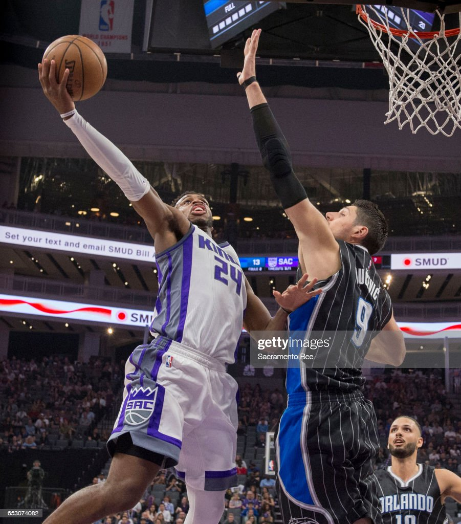Sacramento Kings guard Buddy Hield (24) goes to the basket against Orlando Magic center Nikola Vucevic (9) on Monday, March 13, 2017 at Golden 1 Center in Sacramento, Calif.