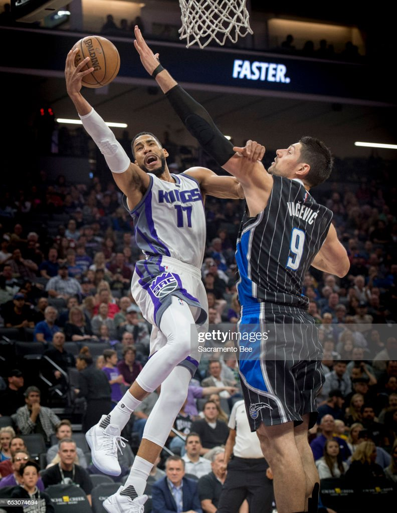 Sacramento Kings guard Garrett Temple (17) goes to the basket against Orlando Magic center Nikola Vucevic (9) on Monday, March 13, 2017 at Golden 1 Center in Sacramento, Calif.