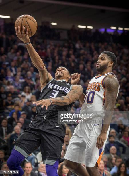 Sacramento Kings guard George Hill goes to the basket against the Phoenix Suns guard Troy Daniels on Tuesday Dec 12 at the Golden 1 Center in...