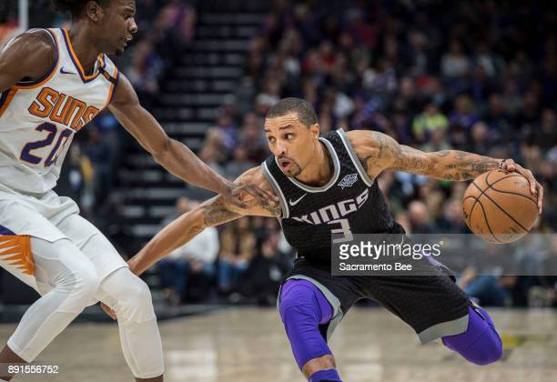 Sacramento Kings guard George Hill looks to make a play against the Phoenix Suns forward Josh Jackson on Tuesday Dec 12 at the Golden 1 Center in...