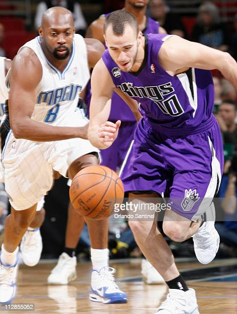 Sacramento Kings guard Sergio Rodriguez breaks away from Orlando guard Anthony Johnson in NBA action at Amway Arena in Orlando Florida on Friday...
