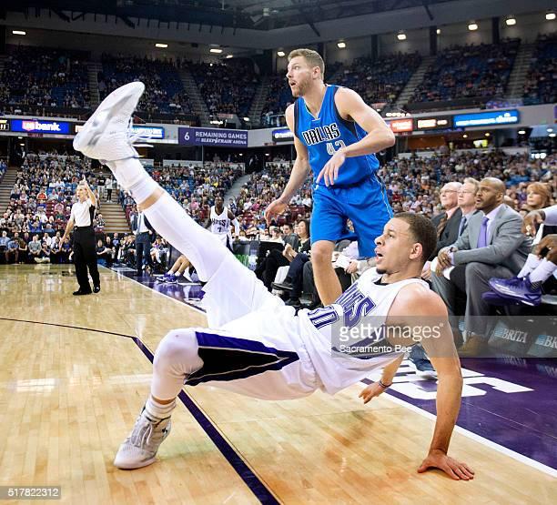 Sacramento Kings guard Seth Curry follows through on a threepoint attempt as Dallas Mavericks forward David Lee watches on Sunday March 27 at Sleep...