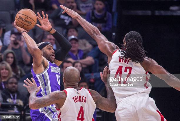 Sacramento Kings guard Vince Carter looks to make a pass as he's defended by Houston Rockets forward PJ Tucker and Houston Rockets center Nene...