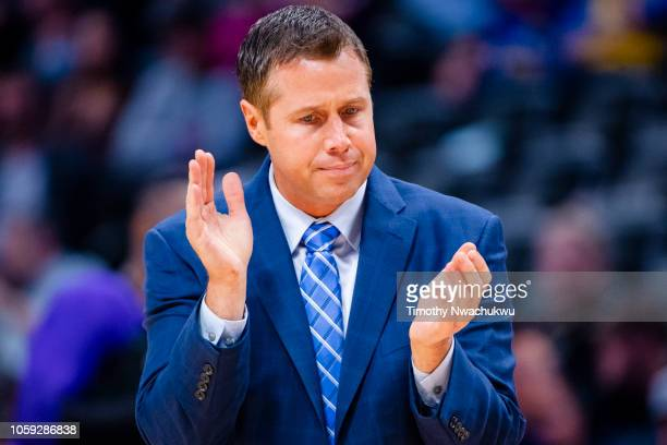 Sacramento Kings head coach Dave Joerger applauds before a timeout during the first half against the Denver Nuggets at Pepsi Center on October 23...