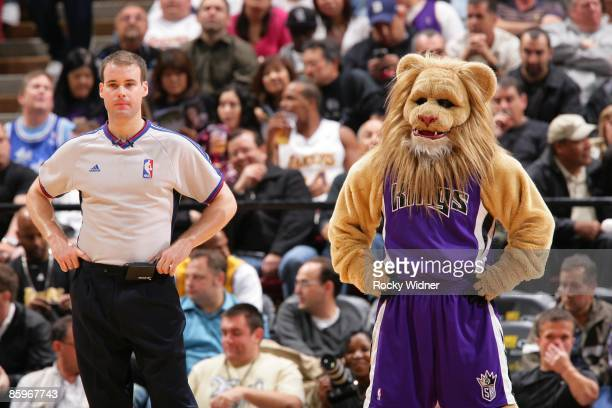 Sacramento Kings mascot Slamson mimics referee Mark Lindsay during the game between the Sacramento Kings and the Los Angeles Lakers at Arco Arena on...