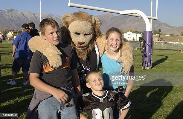 Sacramento Kings mascot Slamson poses for a photo when not playing football against the Lehi 6th grade football team on October 14 2004 in Lehi Utah...