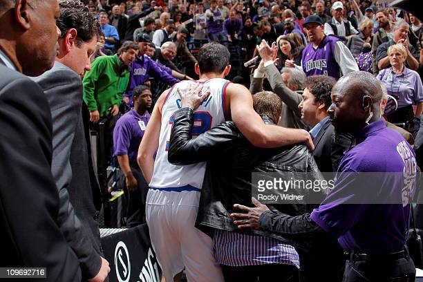 Sacramento Kings owner Joe Maloof walks off the court with Omri Casspi of the Sacramento Kings after defeating the Los Angeles Clippers on February...