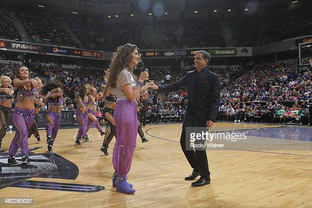 Sacramento Kings owner Vivek Ranadive and his daughter Anjali Ranadive entertain the fans during halftime of the Los Angeles Lakers against the...