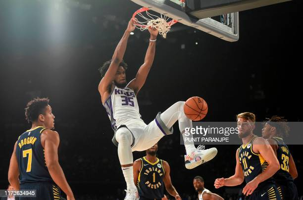 Sacramento Kings player Marvin Bagley shoots a ball as Indiana Pacers players Domantas Sabonis and Malcolm Brogdon look on during the first...