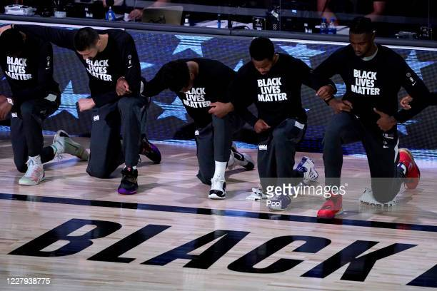 Sacramento Kings players kneel in support of the Black Lives Matter movement prior to an NBA basketball game against the New Orleans Pelicans at HP...