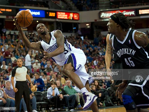 Sacramento Kings point guard Aaron Brooks goes airborne and shoots basket defended by Brooklyn Nets small forward Gerald Wallace in the first half on...
