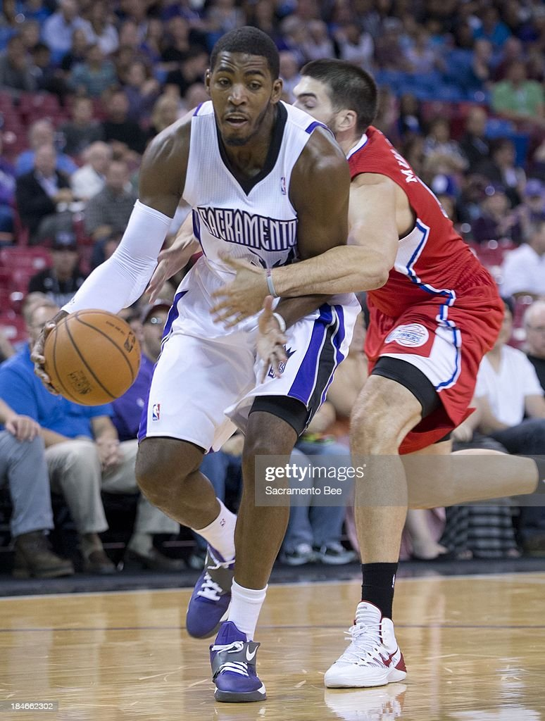 Sacramento Kings power forward Jason Thompson is fouled by