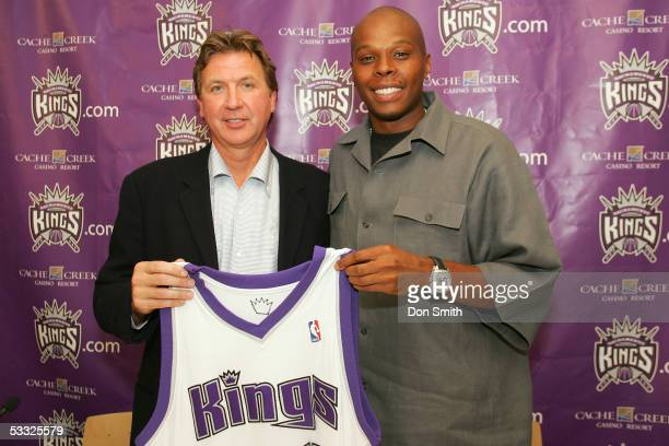 Sacramento Kings President of Basketball Operations Geoff Petrie and Kings guard Bonzi Wells pose during an introductory press conference on August 4...
