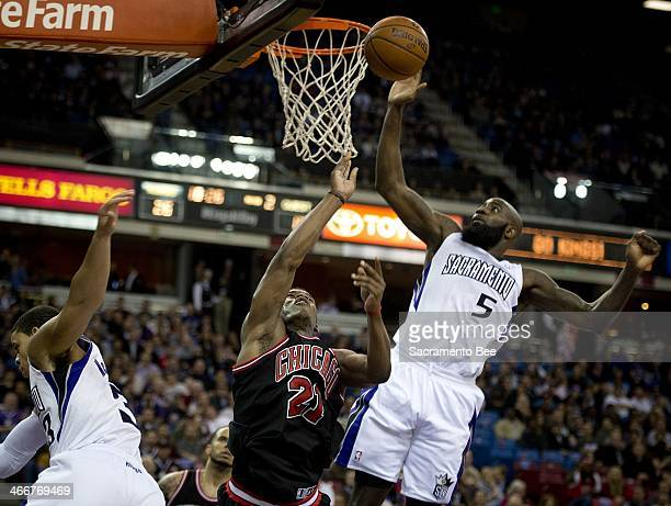 Sacramento Kings small forward Quincy Acy blocks the shot of Chicago Bulls shooting guard Jimmy Butler who was fouled by Sacramento Kings point guard...