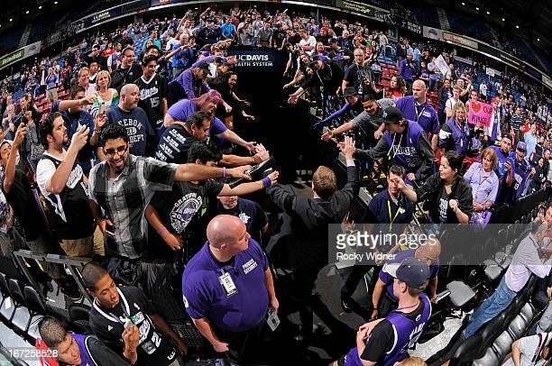 Sacramento Kings TV announcer Grant Napear greets fans while entering the tunnel after the game between the Los Angeles Clippers and Sacramento Kings...