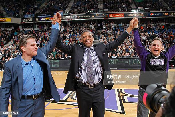 Sacramento mayor Kevin Johnson and owners Joe Maloof and Gavin Maloof of the Sacramento Kings holding up their hands before the game between the Utah...