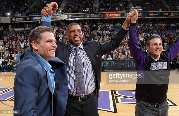 Sacramento mayor Kevin Johnson and owners Joe Maloof and Gavin Maloof of the Sacramento Kings join hands as they address the fans in attendence of...