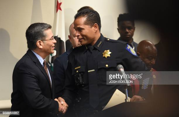 Sacramento Police Chief Daniel Hahn shakes hands with California Attorney General Xavier Becerra after a press conference about the investigation of...