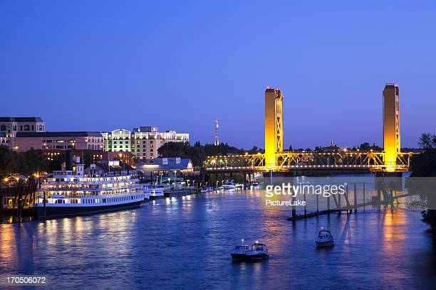 sacramento river and tower bridge at dusk - sacramento stock pictures, royalty-free photos & images