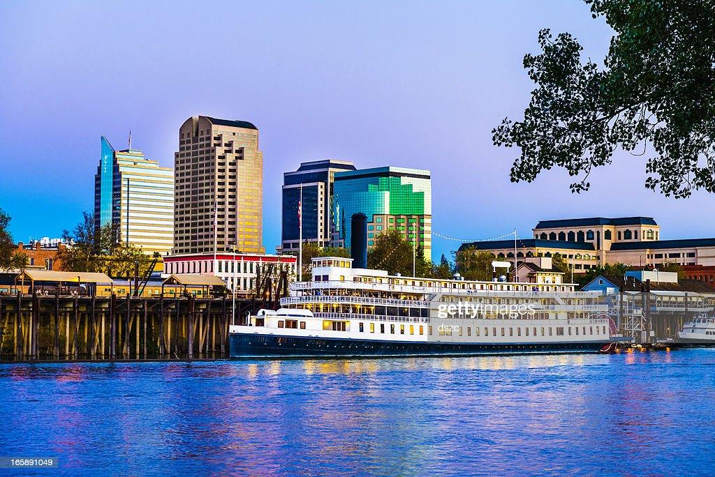 Sacramento skyline and riverfront at dusk : Stock Photo