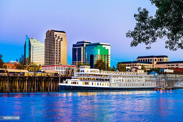 sacramento skyline and riverfront at dusk - sacramento stock pictures, royalty-free photos & images