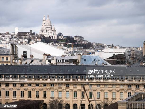 sacré-coeur view from paris rooftop - palais royal stock pictures, royalty-free photos & images