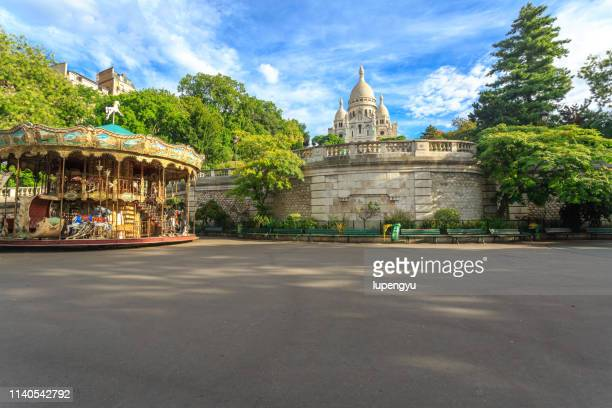 sacre coeur basilica with merry-go-round at morning,paris - 首都 ストックフォトと画像