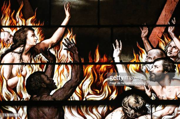 Sacred heart church. Depiction of Hell. Stained glass window.  France.