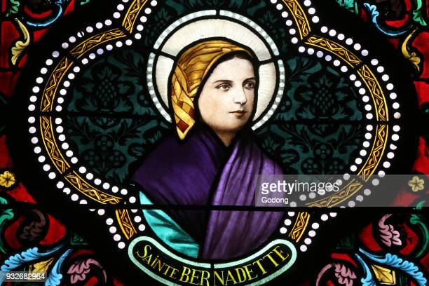 Sacred heart church Stained glass window Ste Bernadette Soubirous is known for the Marian apparitions Moulins France