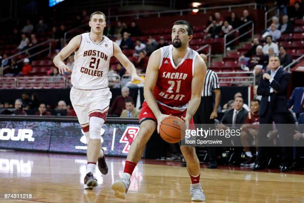 Sacred Heart forward Joseph Lopez looks to the hoop after beating Boston College forward Nik Popovic during a game between the Boston College Eagles...