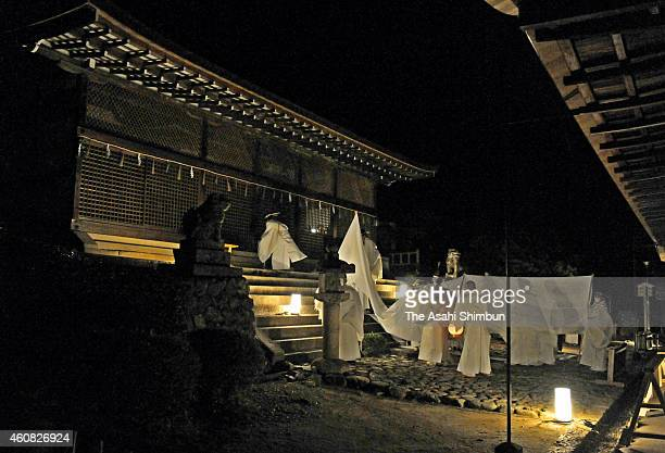 Sacred objects are returned to the main hall of Ujigami Shrine on December 24, 2014 in Uji, Kyoto, Japan. The shrine, a World Heritage site, held a...