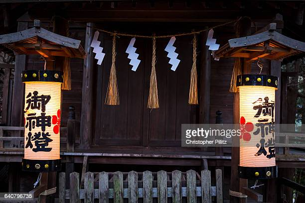 Inside the Yabuhara sanctuary Shimenawa, are lengths of laid rice straw rope used for ritual purification in the Shinto religion. They can vary in...