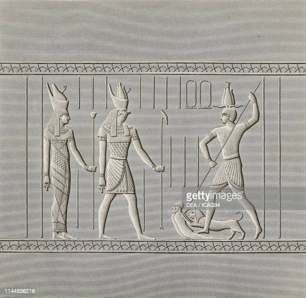 Sacrifice of two men pierced by a spear, while a lion is about to devour them, detail of carved bas-relief, east entrance of Hathor Temple, Dendera...