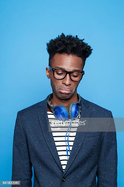 Sad afro american guy in fashionable outfit