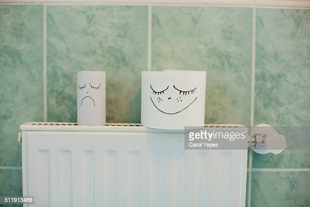 sad and happy toilet paper - funny toilet paper stock-fotos und bilder