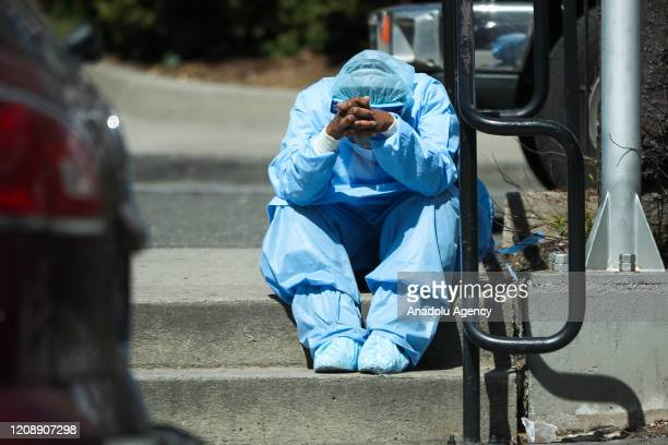 Sad and tired healthcare worker is seen by the Brooklyn Hospital Center in New York, United States on April 1, 2020. New York is the U.S. State...