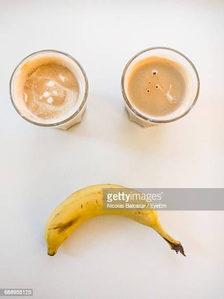 Sad Anthropomorphic Face Made From Banana And Coffee Glass On White Background
