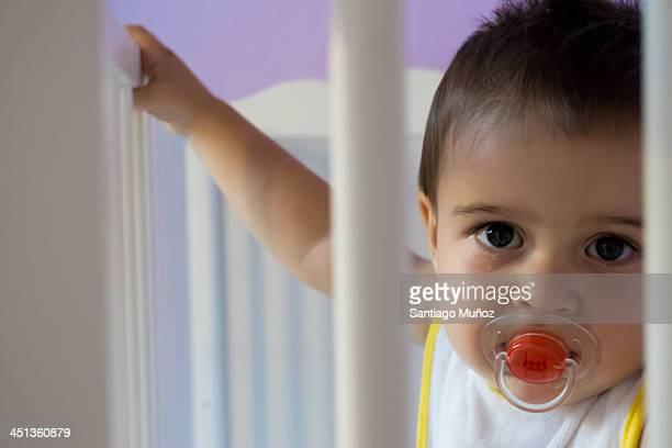 Sad baby in the crib