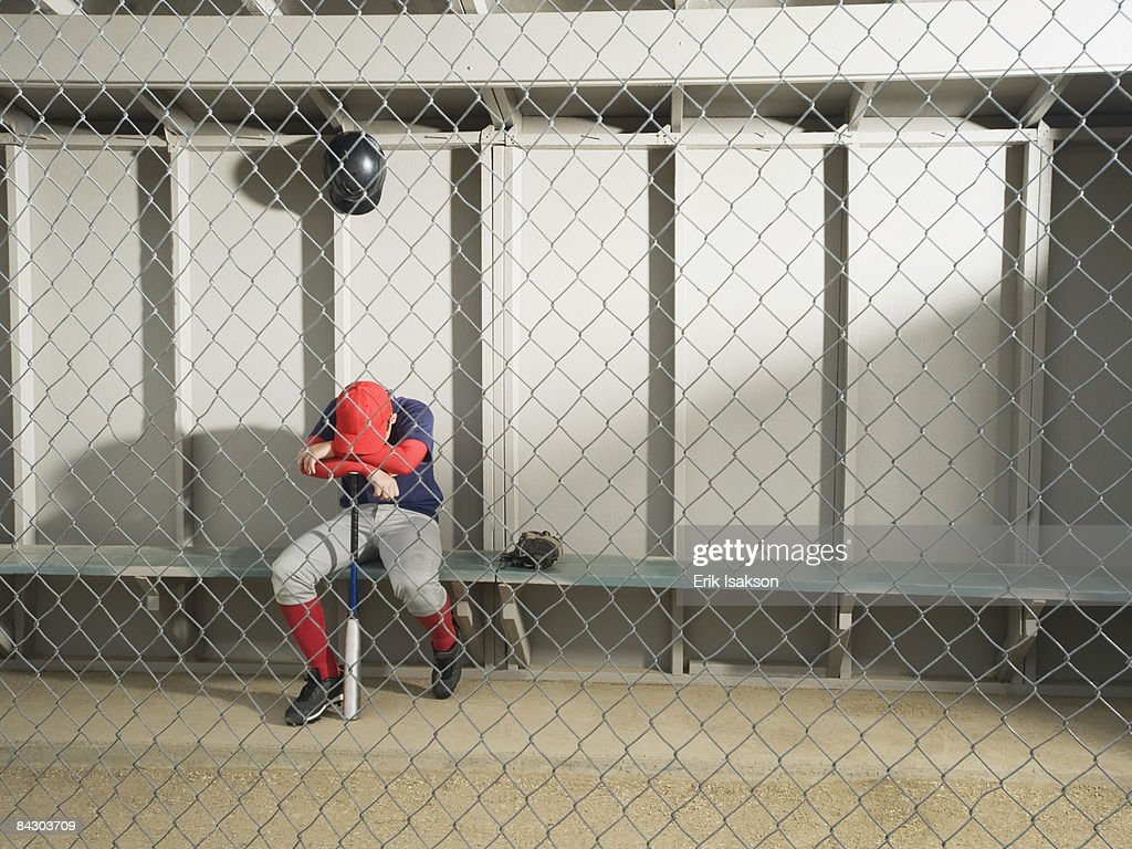 Sad Baseball Player Sitting In Dugout High-Res Stock Photo - Getty ...