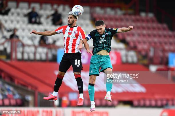 Saïd Benrahma of Brentford battles with Matt Grimes of Swansea City during the Sky Bet Championship Play Off Semifinal 2nd Leg between Brentford and...