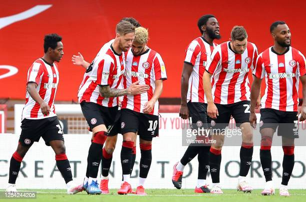 Saïd Benrahma of Brentford FC is congratulated by his captain, Pontus Jansson after completing his hattrick after scoring his third goal during the...