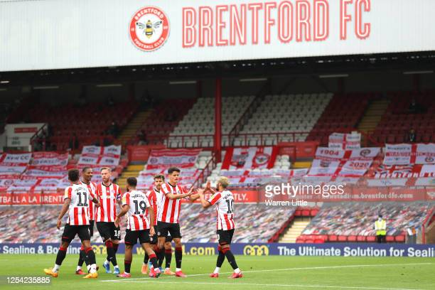 Saïd Benrahma of Brentford FC is congratulated by team mates after scoring the first goal during the Sky Bet Championship match between Brentford and...