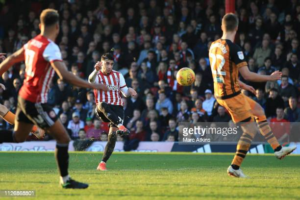 Saïd Benrahma of Brentford scores their 5th goal during the Sky Bet Championship match between Brentford and Hull City at Griffin Park on February 23...