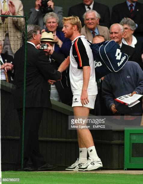 A sad Boris Becker shakes hands with tournament referee Alan Mills as he says goodbye to Wimbledon