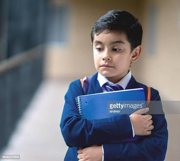 Sad boy at school