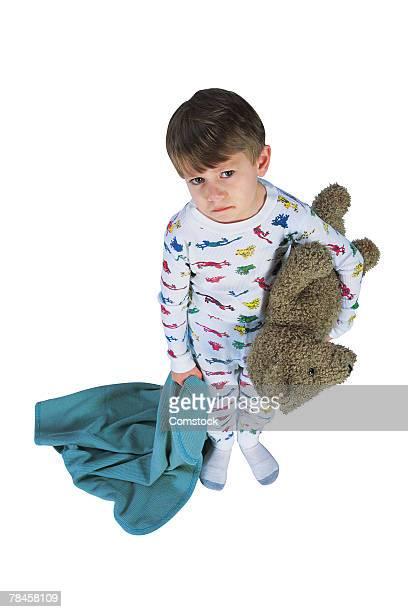 sad boy in pajamas with teddy bear and blanket - alleen jongens stockfoto's en -beelden