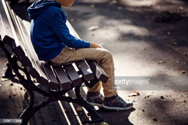 sad boy - sadness stock pictures, royalty-free photos & images