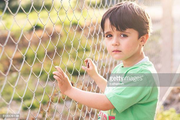 sad boy - orphan stock pictures, royalty-free photos & images