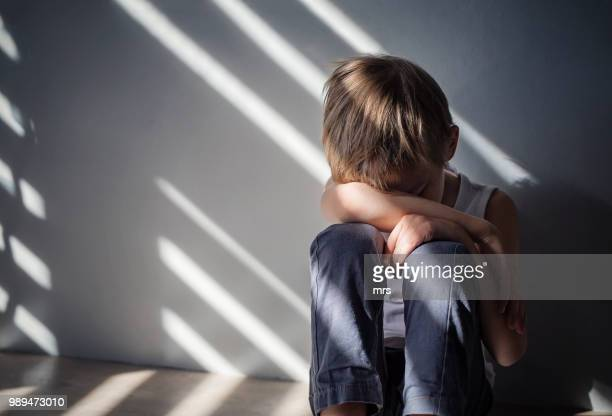 sad boy - autism spectrum disorder stock photos and pictures